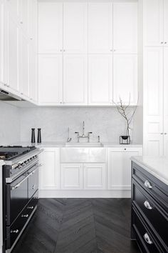 These tall shaker style cabinets take advantage of the soaring ceilings in this luxury kitchen. I also love the Carrera marble kitchen backsplash
