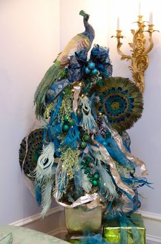 YES Spaces peacock tree Create a Peacock Tree with Paper Feathers - Isn't this beautiful?  if you want to create the feathers there is a youtube video to go with this.