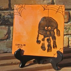 Halloween Hand print on Tile...maybe not on a tile for preschool, but maybe a group project?????  details soon  :)