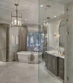 Pale grey bathroom. Pale grey bathroom with greywash cabinet. Pale grey bathroom with marble flooring and marble wall tile. Pale grey bathroom #Palegrey #bathroom Candelaria Design Associates
