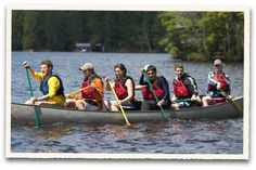 Summer students on break from work and class take a canoe out for a ride at HoneyRock.