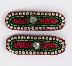 Maroon thread edging with diamonds and green beading embroidery with one big diamante in the center. Snap clip, diamantes, hand embroidered. Maroon, Green, Beading, Diamante, Round Crystal Rectangle with rounded edges; Approx. 1 1/2 inches length by 1/2 inch width. Unique and beautiful on young girls and adults. £8.00 on Etsy... Please click on the Etsy link to purchase.