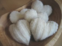 soft and lovely white felted hearts made from a sweater