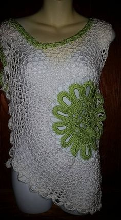 My distinctive version of the very popular crochet top that you see in boutiques and online. Pattern Includes