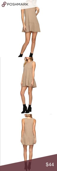 """Free People Womens Brittany Peplum Dress Stone Free People Dress boasts a lightweight cotton fabrication. Shift silhouette with flared hemline. Round neckline. Sleeveless design. Straight hemline. Pullover styling. Perfect for the spring, this breezy tunic has a feminine peplum hem and cool dropped waist. 33"""" length (size Medium) Slips on over head Scooped neck Sleeveless Unlined 100% cotton Machine wash cold, tumble dry low L13 Free People Dresses"""