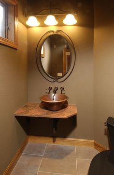 MQ Architecture & Design Faught Cabin traditional powder room featuring Native Trails Cazo hand hammered copper vessel sink in Tempered finish