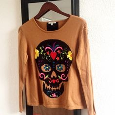 """New Anthropologie mustard skull sweater By Lisa Todd Size Small Skull embroidered sweater dark mustard color beautiful color is the season, more on the fitted side. Measurements length 22.5"""" chest laying flat 19"""" black stripe on the back Anthropologie Sweaters Crew & Scoop Necks"""