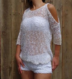 Unique design, soft, feminine, and sexy, an exquisite summer sweater or bikini cover-up. This design is a blend of modern and rustic style. A beautiful loose knit featuring open shoulders, made in a soft thick and thin yarn that gives it a bohemian, hippies look. Knit this top for