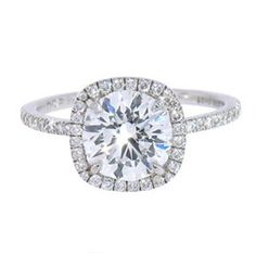 Perfect! Round brilliant diamond in a rounded-square halo. Like the thin band.