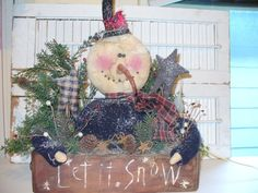 Primitive Christmas snowman in old wooden box