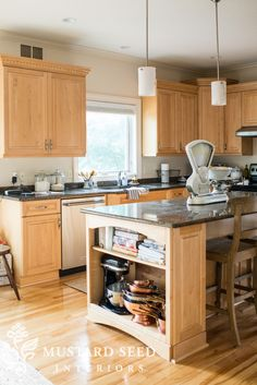 """Do open shelving at ends of island instead of current small cabinets (on sink side).   If the open end shelving is deep enough, put a small microwave there.  Make entire island deeper and install upper cabinets (11-12"""" deep) underneath on stool side of island."""