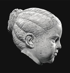 A Roman Marble Portrait Head of a Girl, Trajanic or early Hadrianic, first quarter of the 2nd Century A.D., on 18th-Century Marble Shoulders Total height 39 cm. 15 3/8 in.; height of head 18 cm. 7 1/8 in.