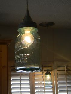 Turn a Ball Jar into a pendant light    I'd like these for over the kitchen sink....