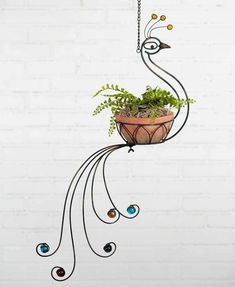 Peacock Hanging Planter is part of Hanging planters - 21 x x 32 Includes 10 chain and hook for hanging Flower Planters, Hanging Planters, Flower Pots, Garden Planters, House Plants Decor, Plant Decor, Porch Plants, Indoor Plants, Wrought Iron Decor