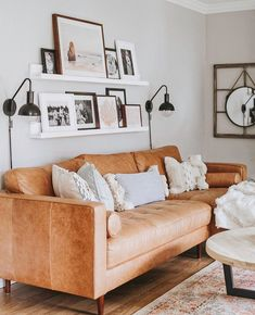 Aug 2019 - lights + floating shelves w/different sized picture frames Living Tv, Home Living Room, Living Room Designs, Modern Living, Sconces Living Room, Living Room Shelves, Shelves Over Couch, Shelving Behind Couch, Book Shelves