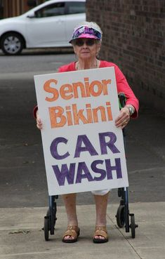 Old Grandma with sign Senior Bikini Car Wash ~ Awkwardly Funny Family Photos