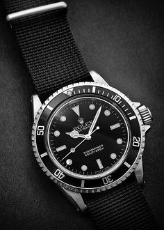 Vintage Rolex Submariner with Black NATO Strap.