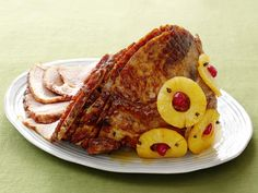 Paula Deen's Old-Fashioned Holiday Glazed Ham. 1 spiral sliced half ham, 1 can pineapple, 3/4 cup packed light brown sugar, 2 tablespoons yellow mustard.  Mix glaze in bowl and spoon over ham and bake. Transfer ham and let rest for a few minutes before cutting.