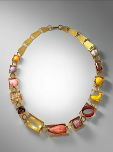 """Helen Britton, """"Boxes and Components"""" Necklace (2010) Gold plated silver, plastic polymer, and found objects. Metropolitan Museum of Art."""