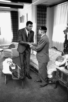 Muhammad Ali visits Nation of Islam leader Elijah Muhammad in his Chicago home by Thomas Hoepker, 1966