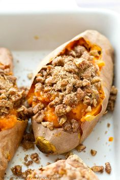 Piled high with buttery pecan streusel topping and baked twice to perfection, these twice-baked pecan streusel sweet potatoes will be the biggest hit of your Thanksgiving dinner! @WholeHeavenly