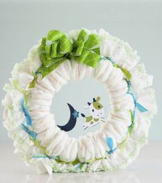Cricut Mini - Baby Diaper Wreath at Joann.com- The possibilities for this are endless! It's a modern take on the diaper cake!