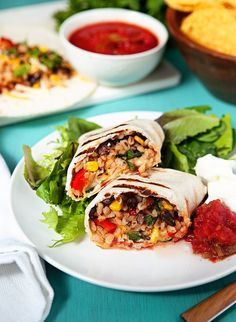 Vegetarian Slow Cooker Burritos: Hearty, healthy, colorful crock pot burritos with a vegetarian Tex-Mex twist. Easy to make and delicious to eat! Fast prep for a healthy quick dinner.