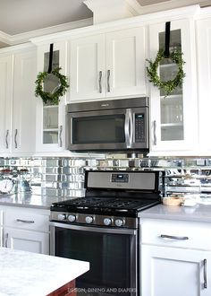 White Kitchen With Boxwood Wreaths