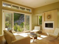 Warm and soothing interiors look bright and lovely thanks to the sliding glass doors
