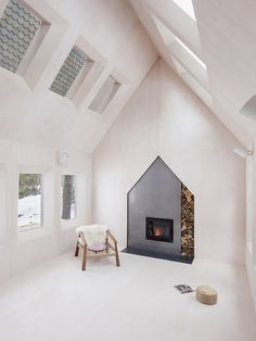 interesting fireplace and I like the scalloped ceiling tiles.