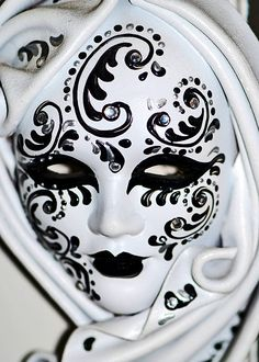 Black and White Venetian mask. #masks #venetianmasks #blackandwhite http://www.pinterest.com/TheHitman14/artwork-venetian-masks-%2B/