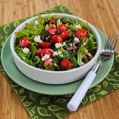 Baby Kale Greek Salad  5 oz. mixed baby kale or chopped kale leaves,   1 cup cherry or grape tomatoes, cut into slices   1/3 cup Kalamata olives, cut into slices    2 oz. Feta cheese, crumbled    Dressing Ingredients:   2 T vinaigrette dressing    2 tsp. fresh-squeezed lemon juice   1/4 tsp. dried Greek oregano   fresh ground black pepper to taste