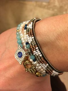 this stack.Evil Eye, freshwater pearl & Hamsa bracelet by BexBohoDesigns + Chan Luu leather seed beed bracelet Spiritual Jewelry, Yoga Jewelry, Soul Shine, Evil Eye Charm, Chan Luu, Hamsa, Fresh Water, Jewelry Design, Beaded Bracelets