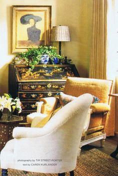 Warm gold and yellows pulling out colors on the chinoiserie chest, with blue accents. Love it.