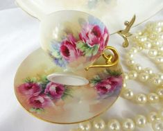 Offered for sale is this gorgeous, 3 piece antique French, Limoges trio consisting of a hand painted, plate, cup and saucer. Each piece features beautiful, Victorian bouquets filled with rich, fuchsi
