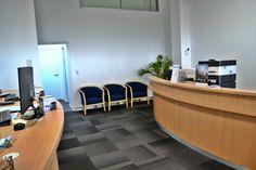 Sunshine Ford Service reception desk, Gold Coast – Birchall & Partners Architects. Architects Ipswich | Architects Brisbane | Architects Gold Coast Brisbane Architects, Receptions, Gold Coast, Showroom, Cool Designs, Sunshine, Garage, Ford, Lounge