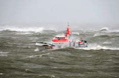 A rescue vessel encounters rough seas in front of the North Sea island Norderney, northern Germany, Thursday, Dec. 5, 2013.