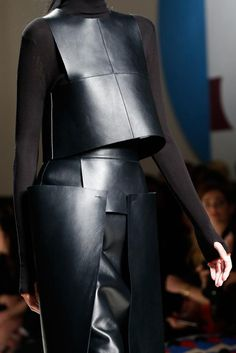 Black leather top + skirt with layered panels; structured fashion details // Fendi Fall 2015
