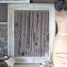 Make this jewelry display from an old frame, linen and cup hooks. Tutorial included.