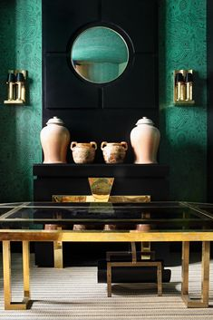 Malachite wallpaper with a French 1970s gold coffee table