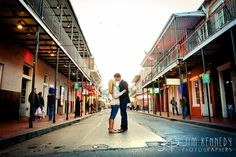 Love this New Orleans street engagement in the heart of the French Quarter!   Bourbon Street, New Orleans engagement, French Quarter engagement photos   Jim Kennedy Photographers