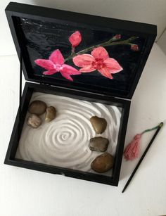 Hidden inside a treasure box, two pink orchids and a zen sand garden for you to discover!   This zen garden will add tranquility and beauty to your home, the office or your bedroom. Used as a meditative tool, for relaxation, touch therapy or simply for play. Makes a wonderful conversation piece. Wonderful gift for someone you love. Kit includes:  High quality / clean / naturally sparkly/ dust free/ white sand, custom made stylus for drawing, smooth stones , and the decora...