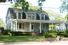 I think I'm partial to a Dutch Colonial Revival style.