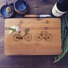 Personalized Cutting Board Wedding Gift, Custom Engraved Chopping Block, His and Hers Bicycles, Engagement Gift, Bike Cutting Board  A beautiful, solid bamboo cutting board / chopping block lovingly engraved with two vintage bicycles and your personalized text. It makes a beautiful, functional, and eco-friendly gift. It's perfect for a wedding, housewarming, anniversary, or any special occasion needing a personal and creative touch ♡  The board will be custom laser engraved to the names…