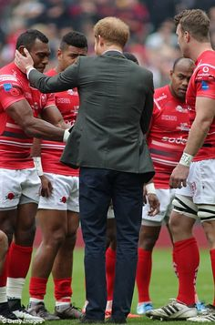 In poignant scenes at Twickenham stadium today, Fijian members of the British Army rugby team kneeled before Prince Harry before their annual grudge match against the Royal Navy.