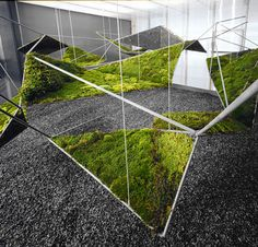 Combining a three-dimensional steel matrix with inset panels of live moss to create a synthetic urban landscape: Moistscape, designed by Freecell.