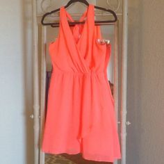 Charlotte Russe Coral Dress! Coral Halter Dress! Size Medium! Been worn a couple times! In very good condition, there is a slight fabric tug on the right side (added a picture.) Beautiful for dressing up and dressing down!  Charlotte Russe Dresses