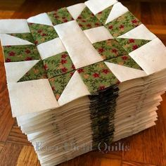 You've heard of the towering inferno? Well meet the towering stack. Forty blocks, all pieced, pressed, trimmed, and layered into one tidy (and teetering) pile. Living in happy-camper land right now. #KimDiehlQuilts #PatchworkBlocks #HenryGlassFabrics