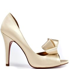 Jazz up your outfit in these feminine heels by Paris Hilton. Senorita features ivory satin throughout with a lady like bow at the vamp. A 4 inch stiletto heel completes this d'orsay heel.