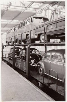 """Loading """"new"""" 1955 Beetles and Buses at Wolfsburg factory."""